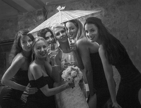 bride and bridesmaids under parasol - The Bride at Son Marroig