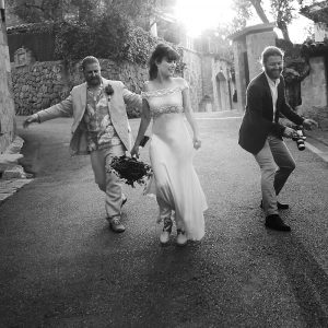 bride with two men descending street