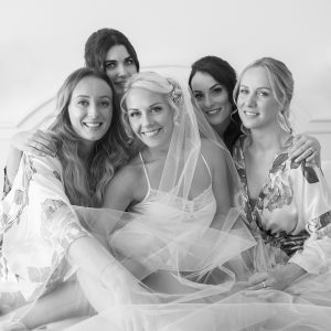 bride on bed during bridal preparations