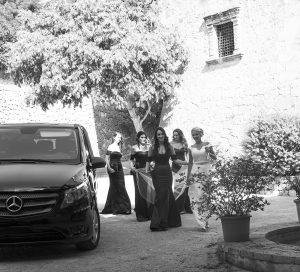 bride with her bridesmaids alighting the wedding car