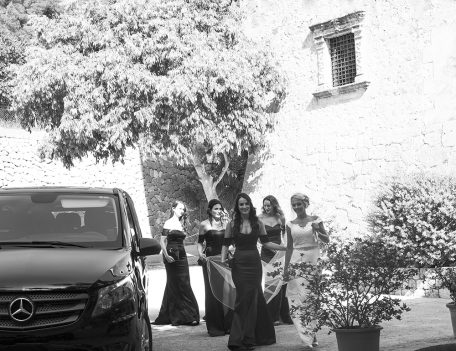 bride with her bridesmaids alighting the wedding car - The Bride at Son Marroig