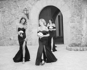 bridesmaids enter courtyard at Son Marroig