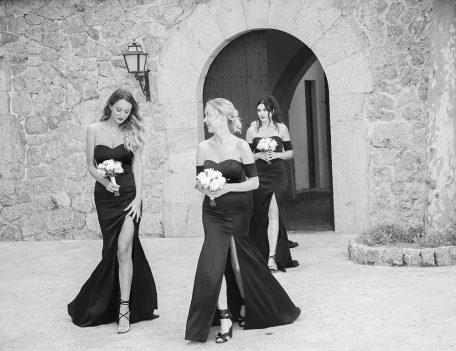 bridesmaids enter courtyard at Son Marroig - The Bride at Son Marroig