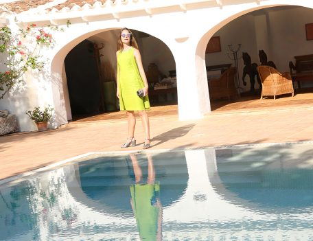 woman by swimming pool in dress - Santa Barbara