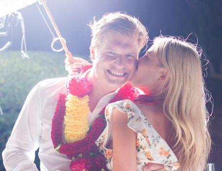 girl kissing boy on cheek - Santa Barbara