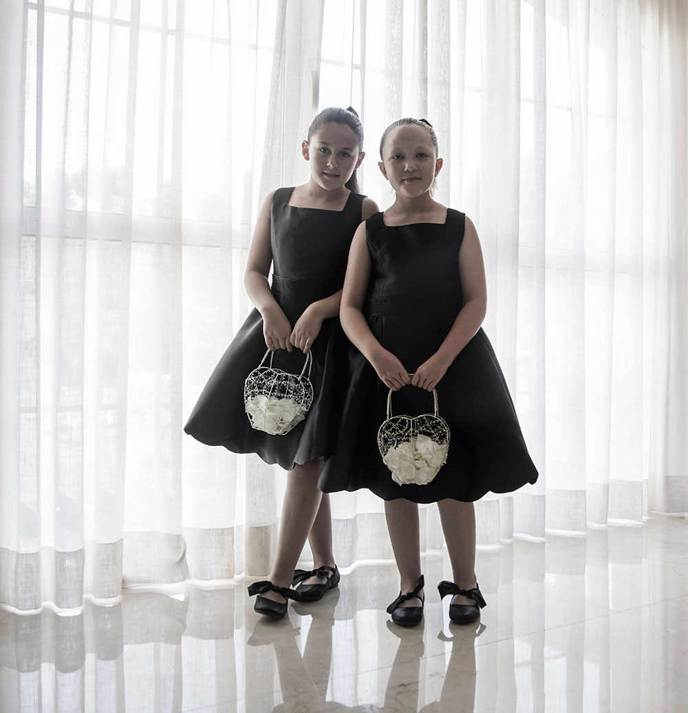 two bridesmaids in black
