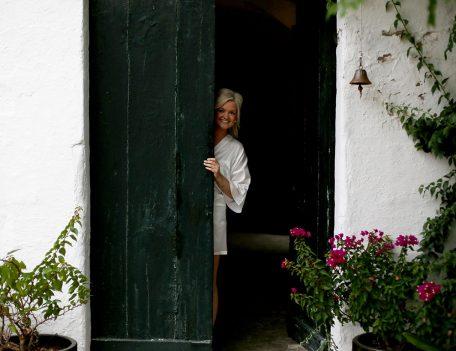bride looks from doorway - Binissaida Bride