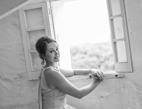 bridesmaid near window - Binissaida Bride