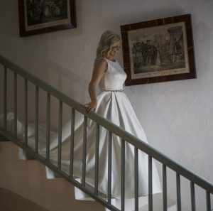 bride walks down staircase