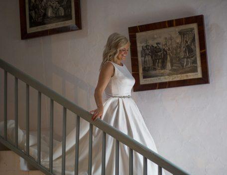 bride descending the staircase - Binissaida Bride