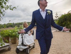 bride on mobility scooter with groom