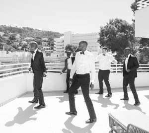 Groom and groomsmen in wedding suits