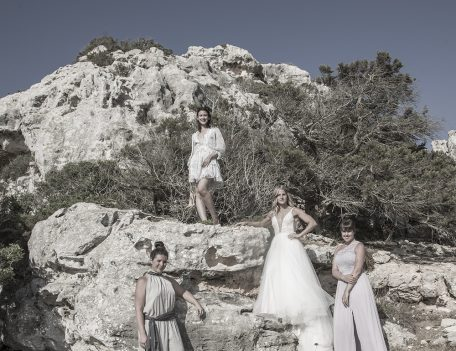 bride with friends on rock for wedding photograph - Villa Binisegarra