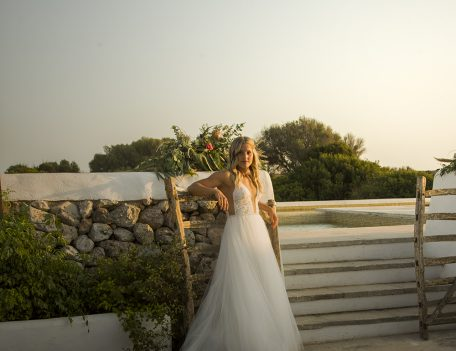 bride leaning on Menorcan gate - Villa Binisegarra